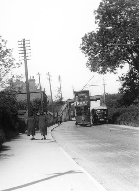 A tram and Williamson's bus passing each other, Nottingham Road, Ripley, c 1920-1940s