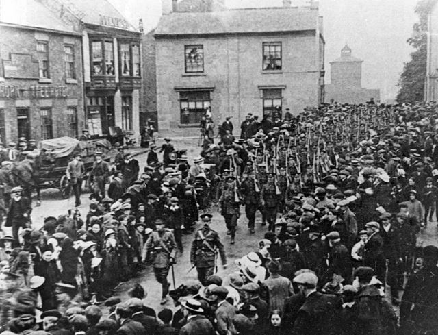 Soldiers marching across Ripley Market Place