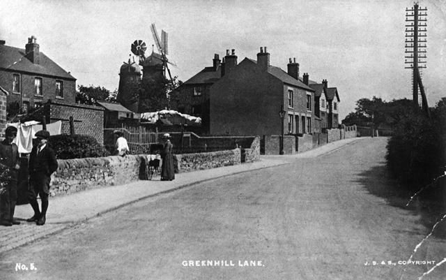 Street scene showing windmills, Greenhill Lane, Riddings, c 1900