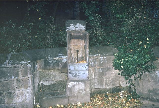 Water pump on wall of Church Hall site, Duffield