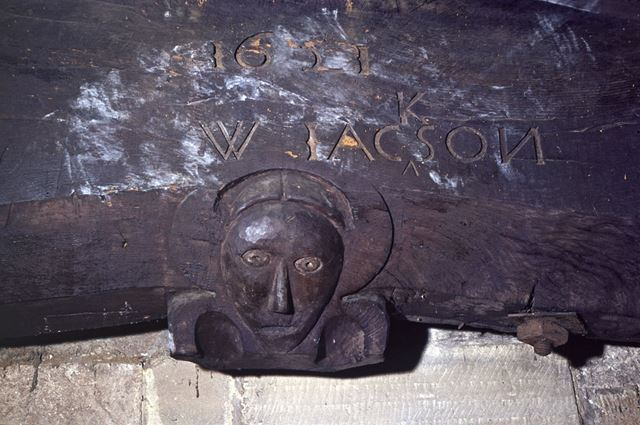 Carving in beam in Chancel Arch, Duffield, dated 1621