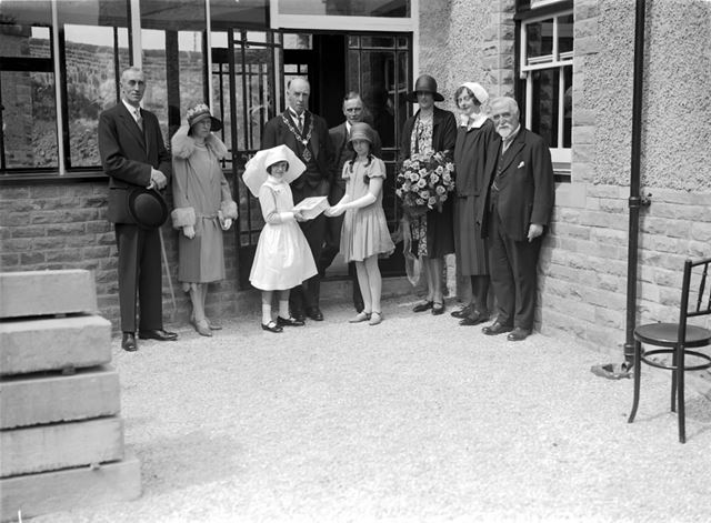 Presentation to Official Party by Miss Mirabelle Mackintosh at the opening of the new Children's War