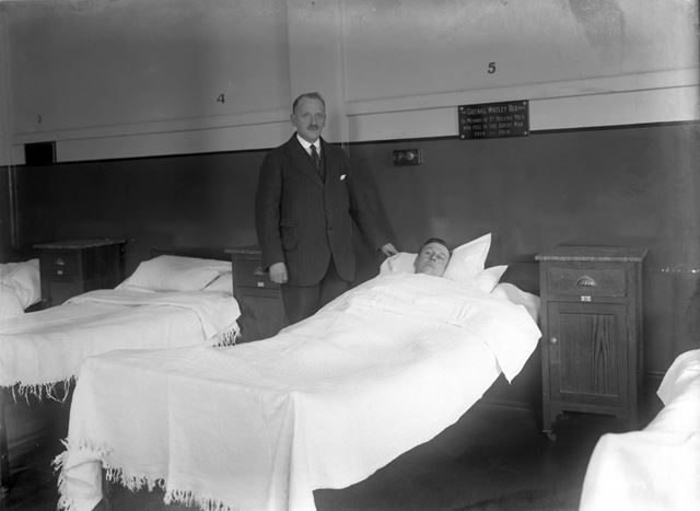 Doctor attending patient in Greenall-Whitley gifted bed - The Devonshire Royal Hospital