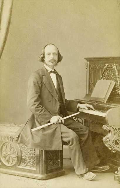 Julian Adams, pianist and performer, conductor of the Pavilion Orchestra