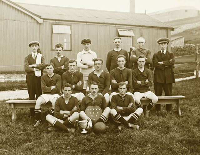This photo was taken outside Harpur Hill Club. Of what was the football team in the 1920's.