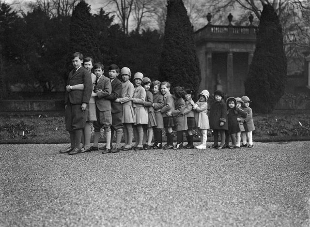 Cavendish family group of 16 grandchildren in the gardens of Chatsworth, Christmas 1929