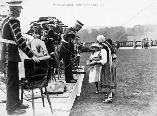 Bandsmen and trinket sellers at Garden Fete, Chatsworth House, 1922
