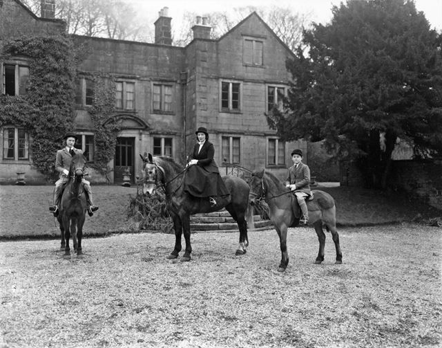 Shaen Stuart-Buttle, her mother, Ann, and brother Richard with horses at Wormhill Hall, Buxton, 1945