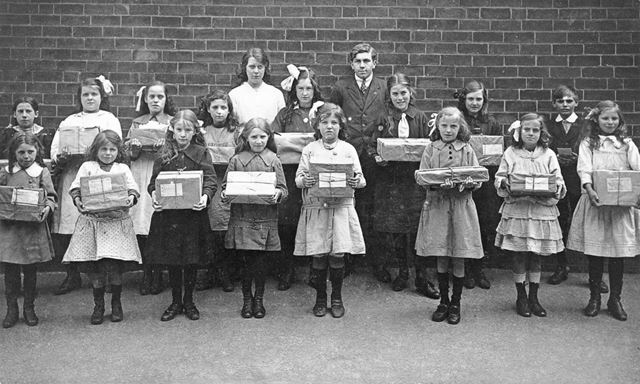 School children holding parcels for P.O.W.'s