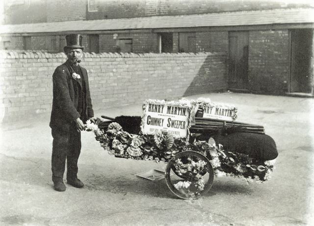 Chimney sweep and decorated handcart, Brampton, Chesterfield, c 1920
