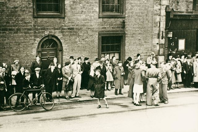 Crowds gathered to watch the V E Day Parade
