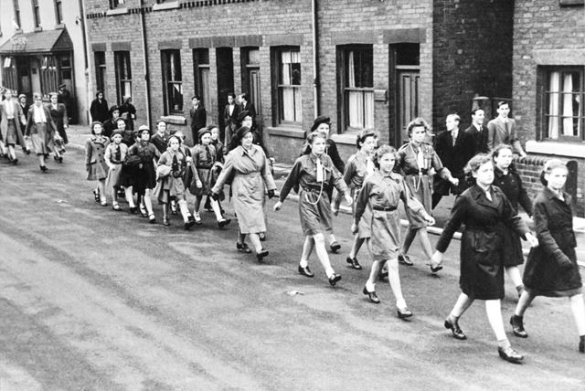 Staveley Brownies marching through Staveley