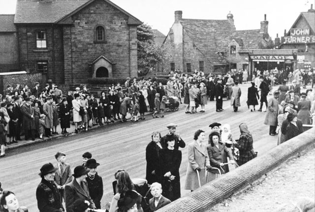 Crowds gathered on Church Street to watch the parade, Staveley
