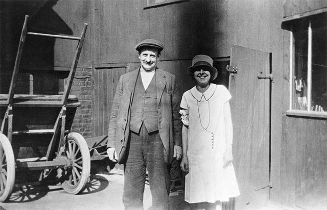 Mr Riley and Olive Boldry in the back yard of Boldry's Shop