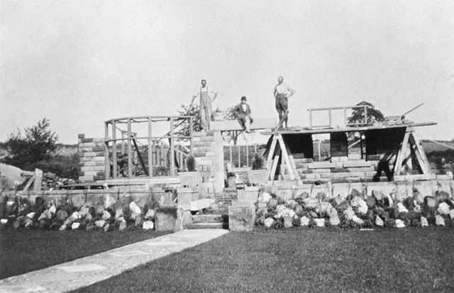 Mr Boldry, Mr Smith and Ivy aloft during construction of The Willows