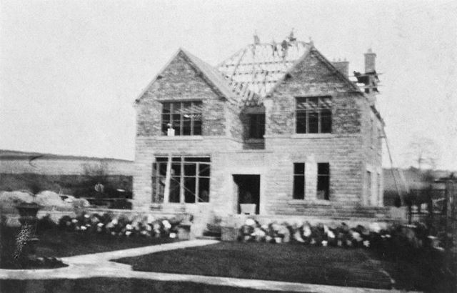 Mr Boldry and builders aloft during construction of The Willows