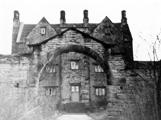 The front elevation of 'The Hagge', and arched gateway