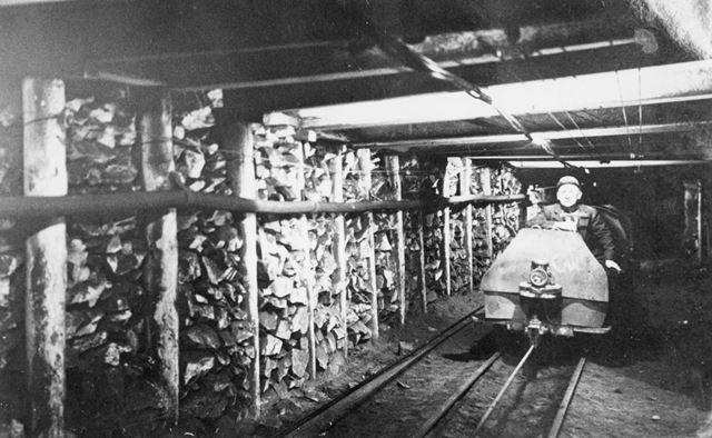 Tommy Liversage (Tommy Dagintop) on a manrider (?) underground at the Ireland Colliery