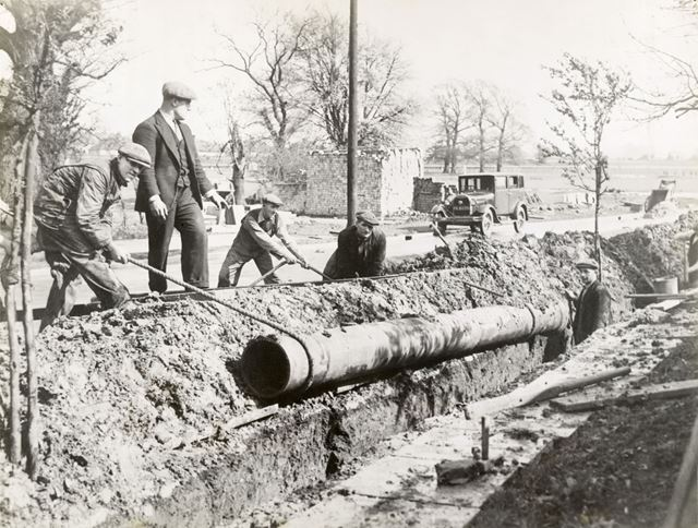 Men laying pipes at Devonshire Works