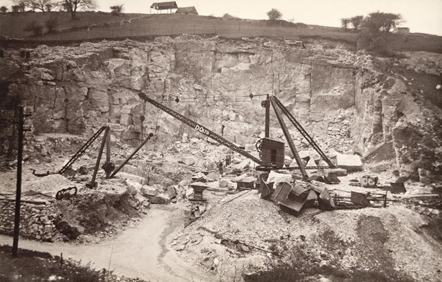 Workmen posed against the Quarry Face
