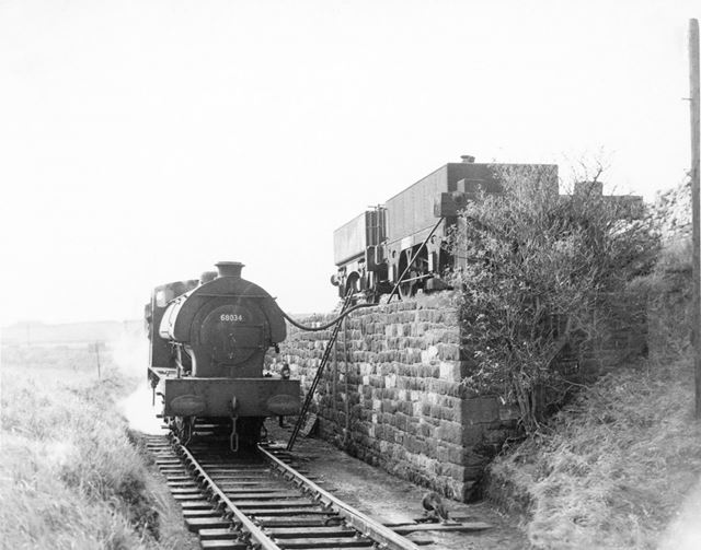 Saddletank Steam engine taking water on The Cromford and High Peak Railway, Longcliffe. 1957