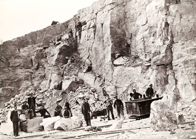 Workmen posed against the Quarry Face at The Dene Quarries