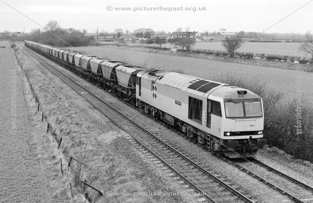 Class 60 locomotive approaching Barrow on Trent, 1993