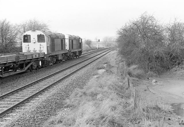 Class 20's passing the old gravel pit