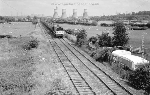 An unidentified Class 58 heads a 'down' coal train west through Birds Fields, Weston on Trent