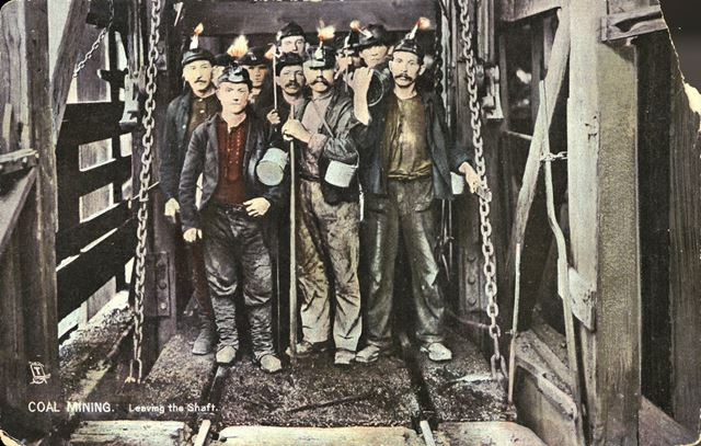 'Coal Mining' - Miners coming out of the lift at the top of the shaft (please note the query below)