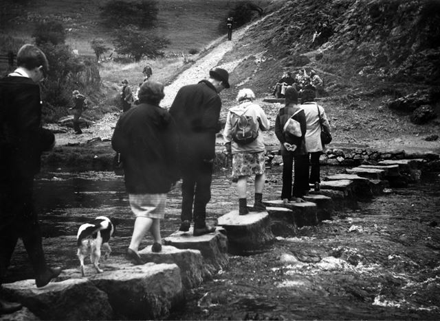 Hikers (and a dog) crossing the stepping stones, Dovedale
