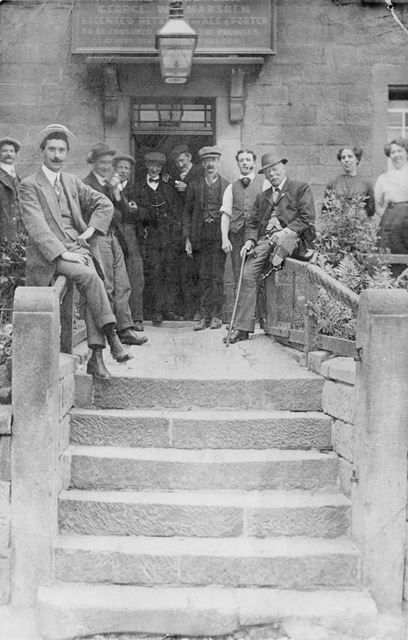 Group of Unknown People Gathered on the Steps of the Thorntree.