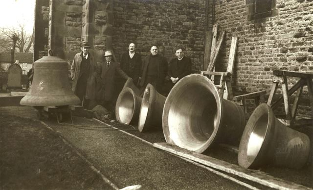 Repaired bells lined up outside the church, Bradwell, 1938