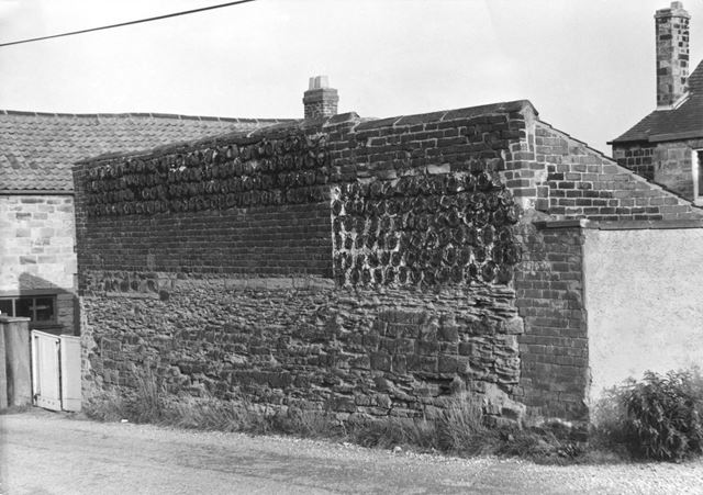 Wall displaying crucible pots built into the structure at the rear of no 2 Stead Street, Eckington