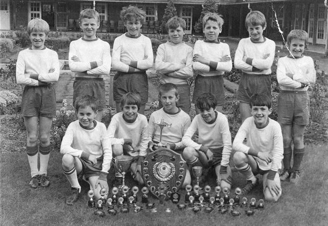 Boys School Football Team with trophies