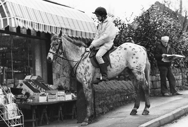 Horse and rider outside the Cottage Stores, Holymoorside, c 1988