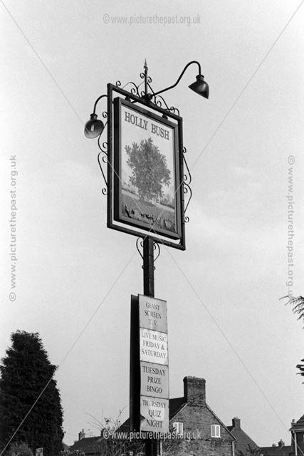 Holly Bush pub sign, corner of High Street and Warren Drive, Linton, 2002
