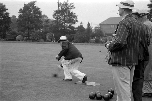 A game of Bowls at the company bowling green.