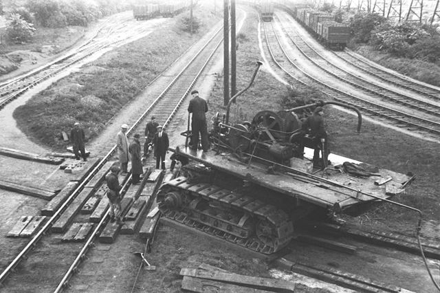 Unloading an excavator from a railway engine at Stanton Old Works