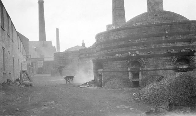 Round down-draught kilns at the brick and sanitary pipe works of W H and J Slater, Denby