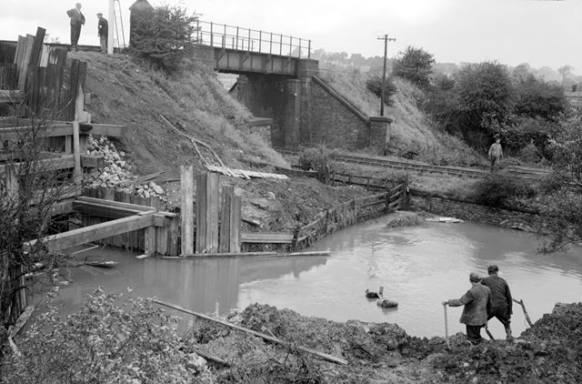 Construction of a new culvert through railway embankment for the diversion of the Nut Brook