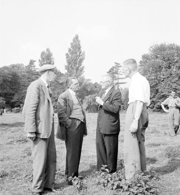 Men conversing (with pipes) at a Stanton Works Annual Flower Show