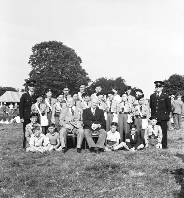 Sir Frederick Scopes and a group of Boy's Brigade or St John's Ambulance members at a Stanton Works