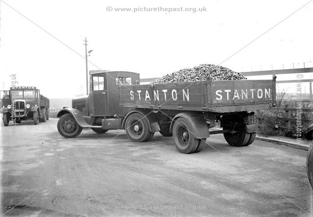 Lorries loaded with tarred slag