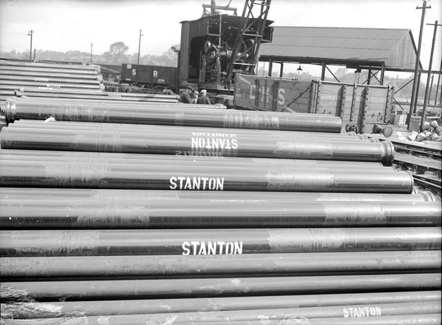 Stack of spun iron pipes