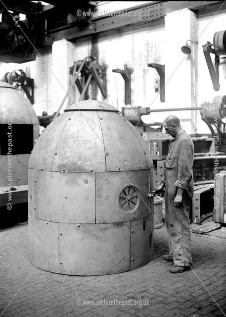 An air  raid shelter assembled from iron segments