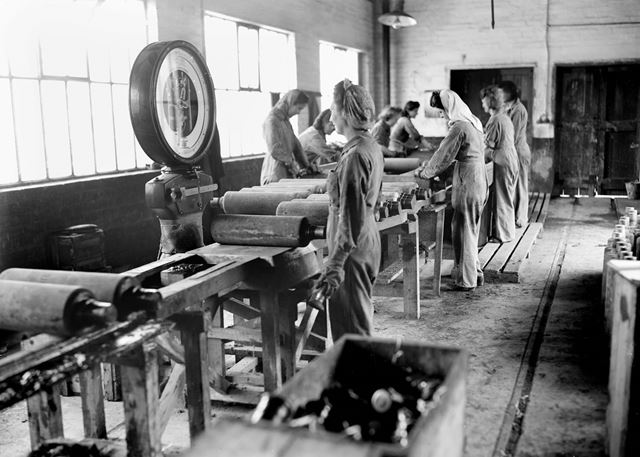 Female employees inspecting concrete practice rocket heads during World War 2 at Stanton Ironworks