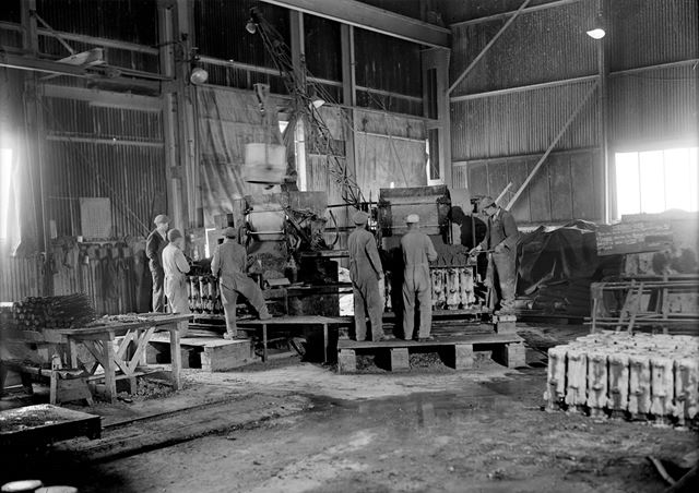 Male employees casting concrete practice rocket heads during World War 2 at Stanton Ironworks