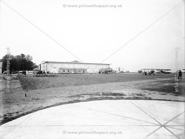 Hangar and aeroplanes at Derby Airport