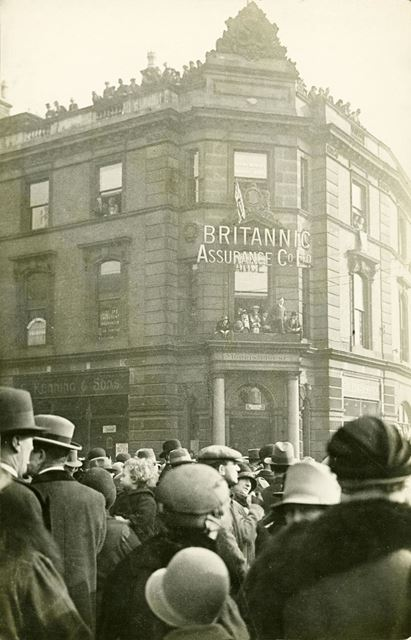 Crowds outside Britannic Assurance offices during the Royal Visit of Edward, Prince of Wales, to Der